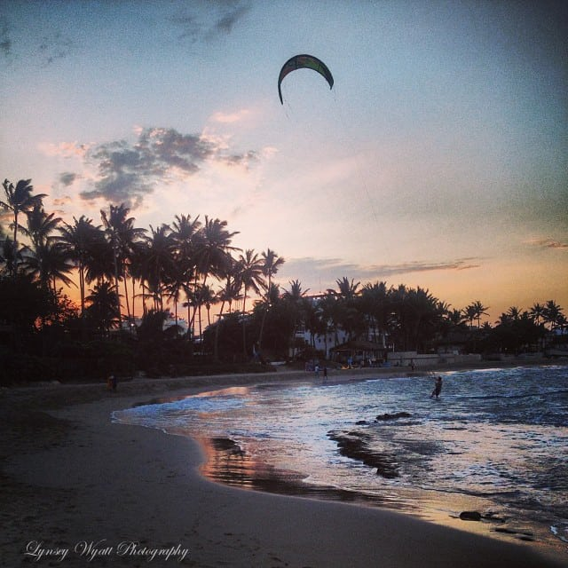 Kite soaring high during a sunset on kite beach.