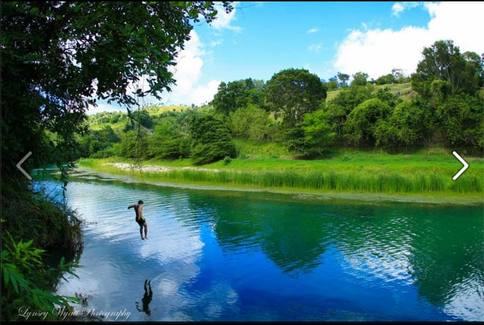 Jumping into the Yassica River at Taino Farm.