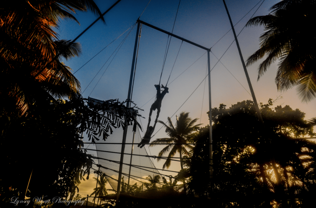 Trapeze Swinger flying trapeze high at Kaicetous Circus at the eXtreme Hotel on Kite Beach.