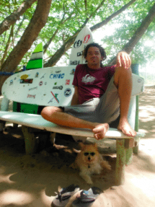 Gene, on of our surf instructors with his famous sunglasses-wearing dog Napoleon.