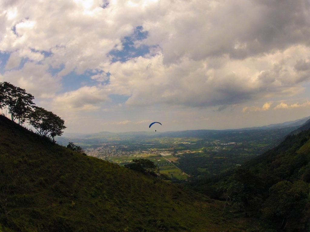 View of the Jarabacoa Valley with a paraglide floating in the distance